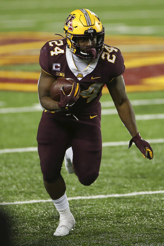 Minnesota running back Mohamed Ibrahim carries during the second half of the team's NCAA college football game against Iowa, Friday, Nov. 13, 2020, in Minneapolis. Iowa won 35-7. (AP Photo/Stacy Bengs)