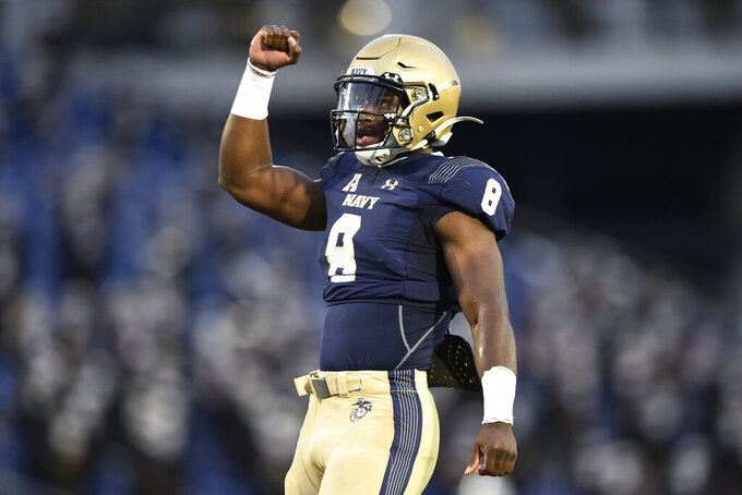 Navy quarterback Dalen Morris celebrates after scoring a touchdown against Temple during the first half of an NCAA football game Saturday, Oct. 10, 2020, in Annapolis, Md. (AP Photo/Gail Burton)