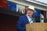 Former longtime state lawmaker John Land acts as emcee at the Galivants Ferry Stump on Monday, Sept. 16, 2019, in Galivants Ferry, S.C. Organizers say the stump meeting, which dates to the 1870s, is the oldest traditional campaign event in the country. (AP Photo/Meg Kinnard)