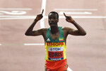 Muktar Edris, of Ethiopia, celebrates after winning the gold medal in the men's 5000 meter final during the World Athletics Championships in Doha, Qatar, Monday, Sept. 30, 2019. (AP Photo/Martin Meissner)