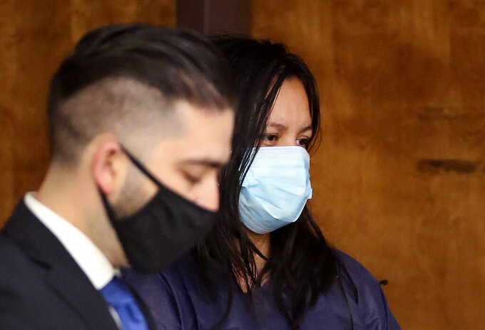 "FILE - In this April 14, 2021, file photo, Liliana Carrillo, right, appears with her representative, Deputy Public Defender Brandon Mata, during her arraignment in Kern County Superior Court in Bakersfield, Calif. The California woman suspected of killing her three children in the midst of a bitter custody battle said Thursday, April 15 that she drowned them to keep them away from their father, a television station reported. In a jailhouse interview, Carrillo told KGET-TV that she wanted to ""protect"" them from abuse, the station reported. (Alex Horvath/The Bakersfield Californian via AP, File)"