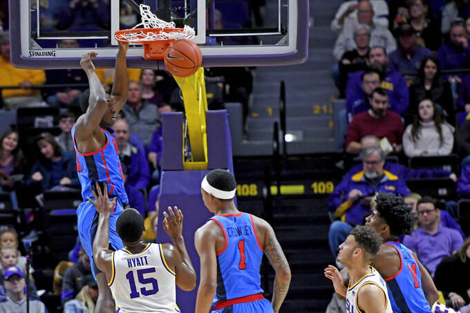 Mississippi forward Sammy Hunter (23) dunks the ball as LSU guard Aundre Hyatt (15) and Mississippi guard Austin Crowley (1) watch in the first half of an NCAA college basketball game, Saturday, Feb. 1, 2020, in Baton Rouge, La. (AP Photo/Bill Feig)