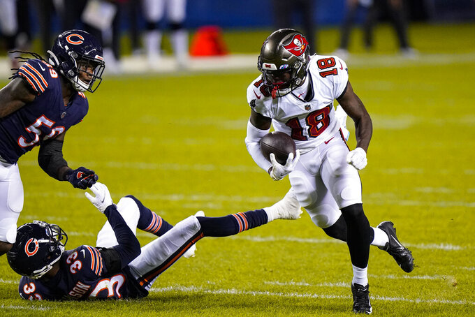 Tampa Bay Buccaneers wide receiver Tyler Johnson (18) runs past Chicago Bears cornerback Jaylon Johnson (33) and inside linebacker Danny Trevathan (59) after a catch during the first half of an NFL football game in Chicago, Thursday, Oct. 8, 2020. (AP Photo/Nam Y. Huh)