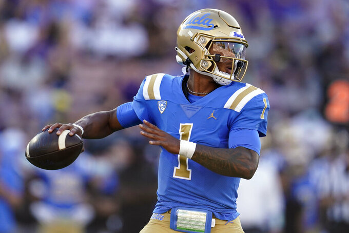 UCLA quarterback Dorian Thompson-Robinson looks for a receiver during the first half of the teams' NCAA college football game against LSU on Saturday, Sept. 4, 2021, in Pasadena, Calif. (AP Photo/Marcio Jose Sanchez)