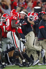 Georgia head coach Kirby Smart celebrates a Georgia interception with defensive back J.R. Reed during the second half of an NCAA college football game, Saturday, Sept. 21, 2019, in Athens, Ga. Georgia won 23-17. (AP Photo/John Bazemore)