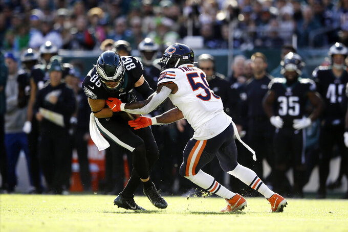 Philadelphia Eagles' Zach Ertz, left, is tackled by Chicago Bears' Danny Trevathan during the first half of an NFL football game, Sunday, Nov. 3, 2019, in Philadelphia. (AP Photo/Matt Rourke)