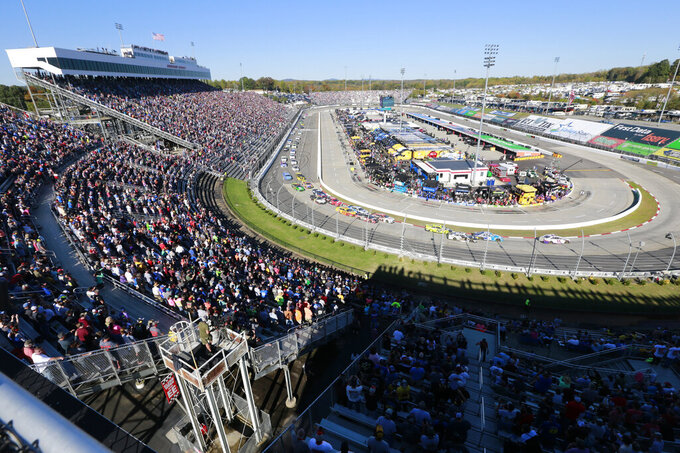 FILE - In this Oct. 27, 2019, file photo, people watch the start of a NASCAR Cup Series race at Martinsville Speedway in Martinsville, Va. Denny Hamlin's dazzling season could potentially collapse if things go sideways Sunday, Oct. 31, 2020, at Martinsville Speedway, NASCAR's oldest and shortest track that has been slotted as the final playoff elimination race. (AP Photo/Steve Helber, File)
