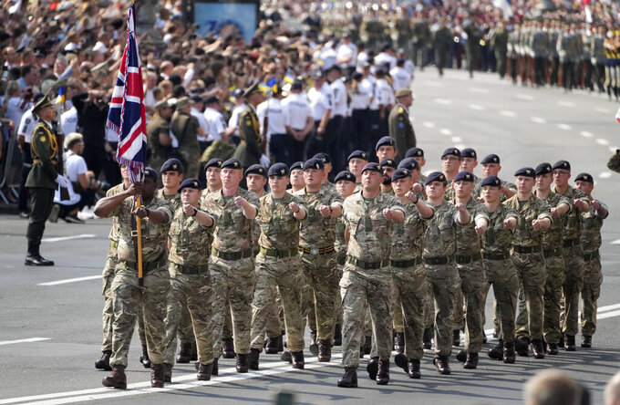 Britain soldiers march along main Khreshchatyk Street during a military parade to celebrate Independence Day in Kyiv, Ukraine, Tuesday, Aug. 24, 2021. Ukraine mark the 30th anniversary of its independence. (AP Photo/Efrem Lukatsky)
