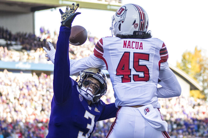 FILE - In this Nov. 2, 2019, file photo, Washington defensive back Elijah Molden breaks up a pass intended for Utah wide receiver Samson Nacua during the first half of an NCAA college football game, in Seattle. Molden was selected to The Associated Press All-Pac 12 Conference team, Thursday, Dec. 12, 2019. (AP Photo/Stephen Brashear, File)