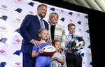 Carolina Panthers NFL football team new head coach Matt Rhule poses with his wife, Julie, and children from left, Vivi, Leanna and Bryant after a news conference at the teams practice facility, Wednesday, Jan. 8, 2020 in Charlotte, N.C. (AP Photo/Mike McCarn)