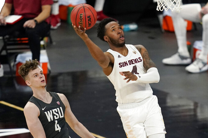 FILE - In this March 10, 2021, file photo, Arizona State's Kimani Lawrence shoots next to Washington State's Aljaz Kunc during the first half of an NCAA college basketball game in the first round of the Pac-12 men's tournament in Las Vegas. The senior big man is one of three players who saw significant playing time last season, averaging 8.1 points and 5.0 rebounds. (AP Photo/John Locher, File)