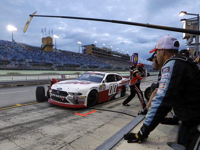 Cole Custer (00) makes a pit stop during the NASCAR Xfinity Series auto race at the Homestead-Miami Speedway, Saturday, Nov. 17, 2018, in Homestead, Fla. (AP Photo/Lynne Sladky)