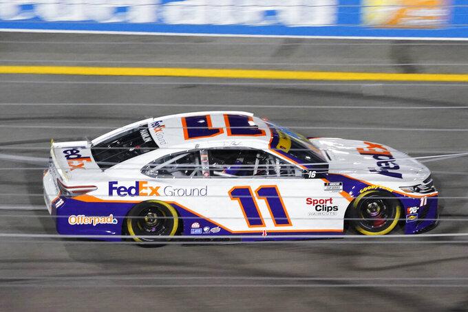 Denny Hamlin (11) heads into turn one during the NASCAR Cup series auto race in Richmond, Va., Saturday, Sept. 11, 2021. (AP Photo/Steve Helber)