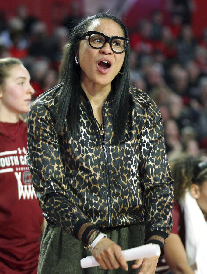 South Carolina head coach Dawn Staley directs her team as they play against Georgia during the second half of an NCAA college basketball game Sunday, Jan. 26, 2020, in Athens, Ga. (AP Photo/Tami Chappell)