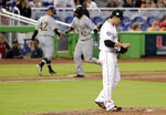 Miami Marlins relief pitcher Junichi Tazawa, right, stands on the mound as Pittsburgh Pirates' Starling Marte,, center, rounds the bases on a solo home run during the ninth inning of a baseball game, Sunday, April 15, 2018, in Miami. (AP Photo/Lynne Sladky)