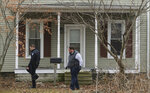 Law enforcement officers walk around a vacant house, Tuesday, Jan. 14, 2020, in Port Clinton, Ohio. where the body of Harley Dilly, 14, was found inside the chimney. The teen had been missing for more than three weeks. (Jeremy Wadsworth/The Blade via AP)