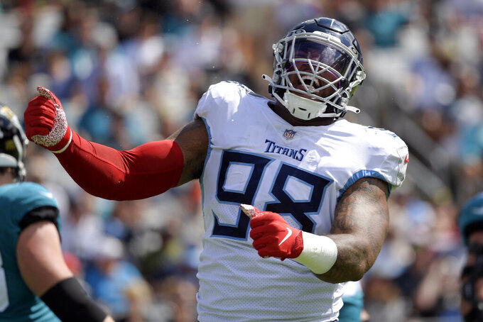 Tennessee Titans defensive end Jeffery Simmons (98) celebrates after making a play against the Jacksonville Jaguars during the first half of an NFL football game, Sunday, Oct. 10, 2021, in Jacksonville, Fla. (AP Photo/Phelan M. Ebenhack)