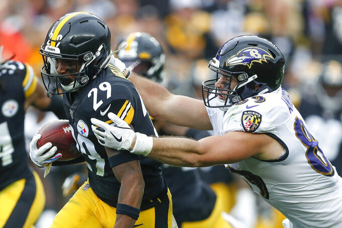 Pittsburgh Steelers defensive back Kam Kelly (29) tries to get away from Baltimore Ravens tight end Mark Andrews (89) after he made an interception in the first half of an NFL football game, Sunday, Oct. 6, 2019, in Pittsburgh. (AP Photo/Don Wright)
