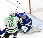 Tampa Bay Lightning goaltender Andrei Vasilevskiy (88) stops Dallas Stars center Jason Dickinson (18) during the third period of Game 5 of the NHL hockey Stanley Cup Final, Saturday, Sept. 26, 2020, in Edmonton, Alberta. (Jason Franson/The Canadian Press via AP)