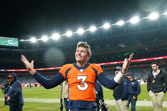 FILE - In  this Dec. 29, 2019, file photo, Denver Broncos quarterback Drew Lock gestures after an NFL football game against the Oakland Raiders in Denver. While stressing that Lock has