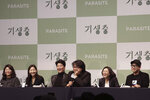 """Bong Joon-ho, director of Oscar-winning """"Parasite,"""" center right, speaks during a press conference in Seoul, South Korea, Wednesday, Feb. 19, 2020. Bong said Wednesday """"the biggest pleasure and the most significant meaning"""" that the film has brought to him was its success in many countries though the audiences might feel uncomfortable with his explicit description of a bitter wealth disparity in modern society. (AP Photo/Ahn Young-joon)"""