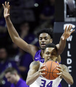 Kansas State forward Levi Stockard III (34) rebounds against TCU center Russell Barlow, back, during the first half of an NCAA college basketball game in Manhattan, Kan., Saturday, Jan. 19, 2019. (AP Photo/Orlin Wagner)