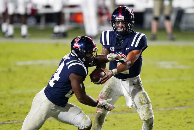 Mississippi quarterback Matt Corral (2) hands off to running back Snoop Conner (24) during the second half of the team's NCAA college football game against Alabama in Oxford, Miss., Saturday, Oct. 10, 2020. Alabama won 63-48. (AP Photo/Rogelio V. Solis)