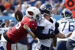 Arizona Cardinals linebacker Chandler Jones (55) sacks Tennessee Titans quarterback Ryan Tannehill (17) and forces a fumble that the Cardinals recovered in the second half of an NFL football game Sunday, Sept. 12, 2021, in Nashville, Tenn. (AP Photo/Mark Zaleski)