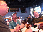 In this Sept. 9, 2019 photo, football fans watch the action on-wall-mounted video screens in the sports betting lounge at the Ocean Casino Resort in Atlantic City, N.J. The coronavirus outbreak has added new wrinkles for bettors this year, but even so, the nation's sportsbooks expect a record year of bets on football in 2020 from an antsy public that has been cooped up for months amid the pandemic. (AP Photo/Wayne Parry)