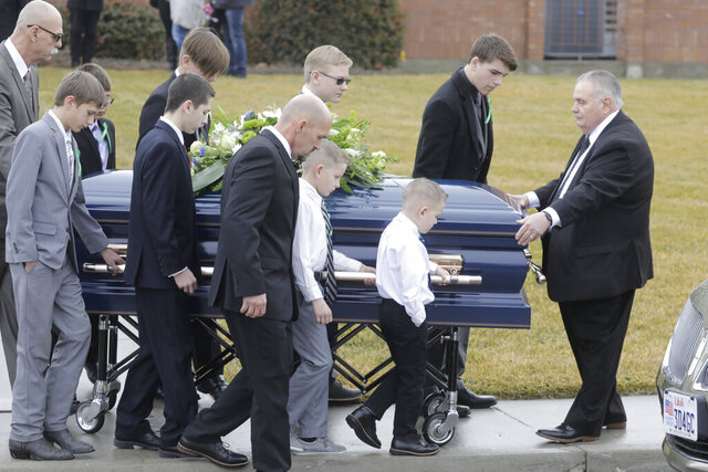 Pallbearers carry a casket following the funeral services for Consuelo Alejandra Haynie, daughters 12-year-old Milan and 15-year-old Alexis and 14-year-old son Matthew Friday, Jan. 24, 2020, in Grantsville, Utah. The killing of a Utah mother and three of her children by a gunman identified by police as her 16-year-old son is