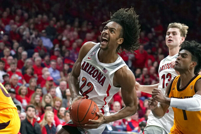 FILE - In this Jan. 4, 2020, file photo, Arizona forward Zeke Nnaji (22) drives against Arizona State,in the first half of an NCAA college basketball game in Tucson, Ariz. Nnaji was selected to the Associated Press All Pac-12 team selected Tuesday, March 10, 2020. Nnaji was also seleced AP Newcomer of the Year. (AP Photo/Rick Scuteri, File)