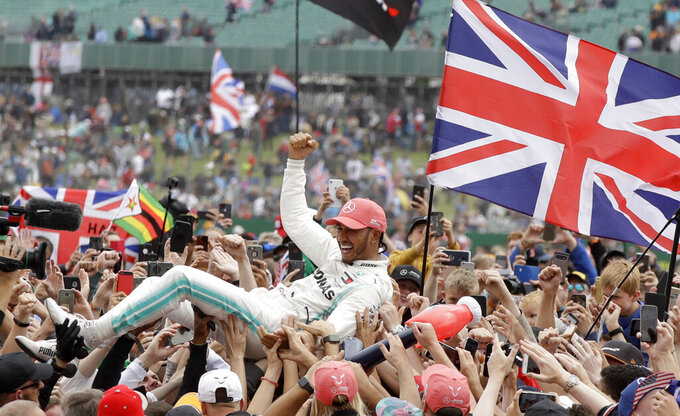 Mercedes driver Lewis Hamilton of Britain celebrates after winning the British Formula One Grand Prix at the Silverstone racetrack, Silverstone, England, Sunday, July 14, 2019. (AP Photo/Luca Bruno)