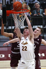 Loyola Chicago center Jacob Hutson (22) shoots over Southern Illinois' Kyler Filewich, right, during the second half of an NCAA college basketball game Friday, Feb. 26, 2021, in Chicago. (AP Photo/Shafkat Anowar)