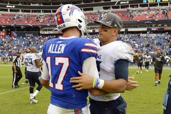 Buffalo Bills quarterback Josh Allen (17) meets Tennessee Titans quarterback Marcus Mariota (8) on the field after an NFL football game Sunday, Oct. 6, 2019, in Nashville, Tenn. The Bills won 14-7. (AP Photo/Mark Zaleski)