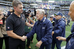 Seattle Seahawks head coach Pete Carroll, center, shakes hands with Cincinnati Bengals head coach Zac Taylor, left, after an NFL football game, Sunday, Sept. 8, 2019, in Seattle. (AP Photo/John Froschauer)