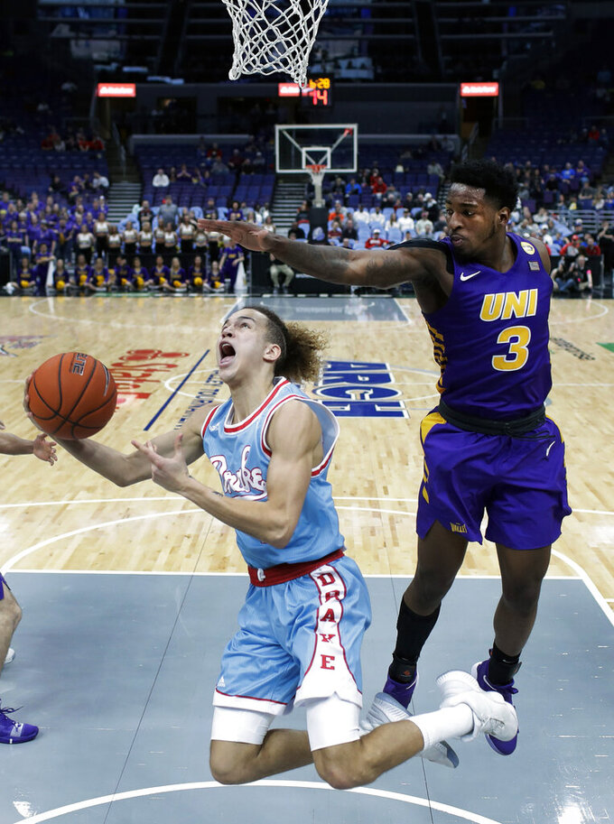 Drake's Noah Thomas shoots as Northern Iowa's Tywhon Pickford (3) defends during the second half of an NCAA college basketball game in the semifinal round of the Missouri Valley Conference tournament, Saturday, March 9, 2019, in St. Louis. Northern Iowa won 60-58. (AP Photo/Jeff Roberson)
