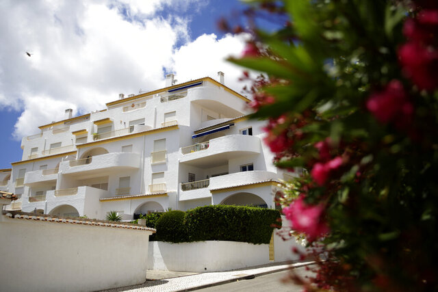 A view of the block of apartments from where British girl Madeleine McCann disappeared in 2007, in Praia da Luz, in Portugal's Algarve coast, Thursday, June 4, 2020. German police have identified a 43-year-old imprisoned German citizen as a suspect in the 2007 disappearance in Praia da Luz of British girl Madeleine McCann. (AP Photo/Armando Franca)