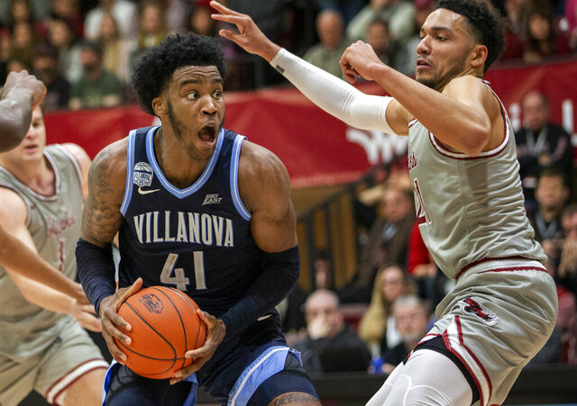 Villanova forward Saddiq Bey (41) moves around Saint Joseph's forward Lorenzo Edwards (21) during the second half of an NCAA college basketball game, Saturday, Dec. 7, 2019, in Philadelphia. Villanova won 78-66. (AP Photo/Laurence Kesterson)