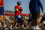 New York Giants quarterback Daniel Jones drops back to pass during an NFL football training camp Saturday, July 31, 2021, in Newark, N.J. (AP Photo/John Munson)