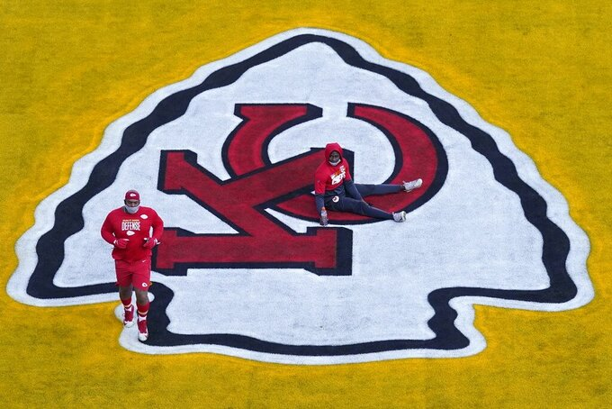 Kansas City Chiefs players warm up before the NFL Super Bowl 55 football game between the Kansas City Chiefs and Tampa Bay Buccaneers, Sunday, Feb. 7, 2021, in Tampa, Fla. (AP Photo/Charlie Riedel)