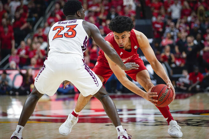 Louisville forward Jordan Nwora (33) plays against Virginia Tech guard Tyrece Radford (23) during the second half of an NCAA college basketball game, Sunday, March 1, 2020 in Louisville, Ky. (AP Photo/Bryan Woolston)