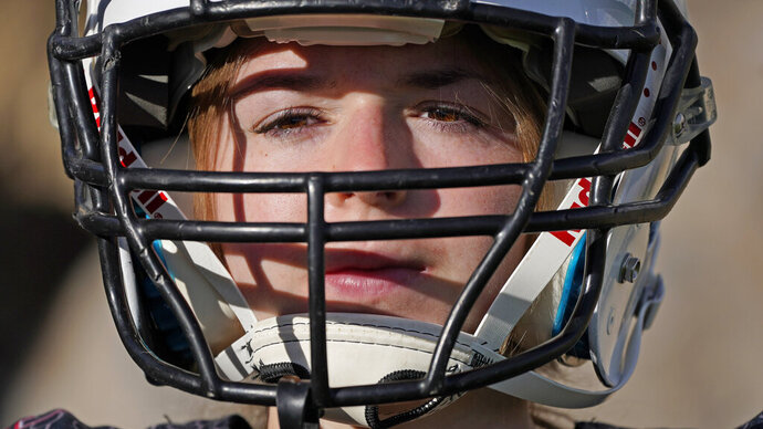 Sam Gordon poses for a photograph, Oct. 20, 2020, in Herriman, Utah. Gordon was the only girl in a tackle football league when she started playing the game at age 9. Now, Gordon hopes she can give girls a chance to play on female-only high school teams through a lawsuit. (AP Photo/Rick Bowmer)