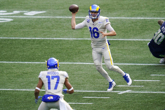 Los Angeles Rams quarterback Jared Goff (16) passes to wide receiver Robert Woods (17) during the first half of an NFL football game, Sunday, Dec. 27, 2020, in Seattle. (AP Photo/Elaine Thompson)