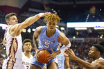 North Carolina forward Armando Bacot (5) regains control of the ball after having it stripped by Florida State in the first half of an NCAA college basketball game in Tallahassee, Fla., Monday, Feb. 3, 2020. (AP Photo/Mark Wallheiser)