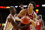 Oklahoma center Jamuni McNeace drives past Iowa State forward Cameron Lard, left, during the first half of an NCAA college basketball game, Monday, Feb. 25, 2019, in Ames, Iowa. (AP Photo/Charlie Neibergall)