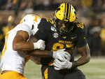 Missouri tight end Daniel Parker Jr., right, is tackled by Tennessee defensive back Nigel Warrior, left, during the first quarter of an NCAA college football game against Saturday, Nov. 23, 2019, in Columbia, Mo. (AP Photo/L.G. Patterson)