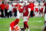 Arizona Cardinals kicker Matt Prater (5) watch his field goal split the uprights as Kansas City Chiefs defensive back Chris Lammons (26) defends during the second half of an NFL football game, Friday, Aug. 20, 2021, in Glendale, Ariz. (AP Photo/Ross D. Franklin)