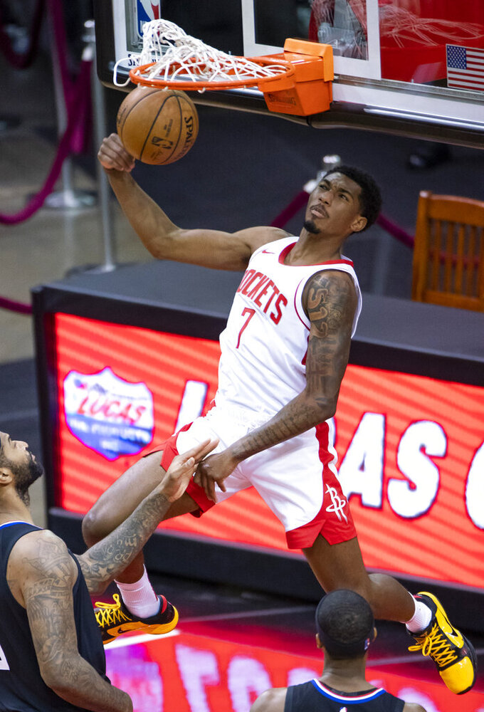 Houston Rockets guard Armoni Brooks (7) dunks against the Los Angeles Clippers during the first quarter of an NBA game Friday, May 14, 2021, in Houston. (Mark Mulligan/Houston Chronicle via AP)