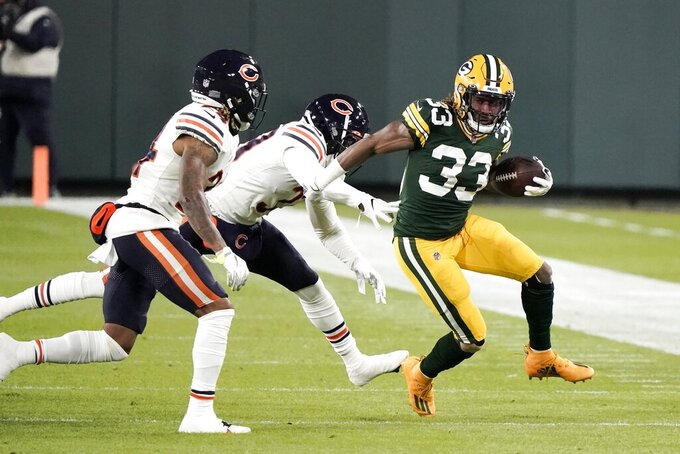 Green Bay Packers' Aaron Jones runs during the first half of an NFL football game against the Chicago Bears Sunday, Nov. 29, 2020, in Green Bay, Wis. (AP Photo/Morry Gash)