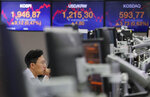 A currency trader watches monitors at the foreign exchange dealing room of the KEB Hana Bank headquarters in Seoul, South Korea, Monday, Aug. 12, 2019. Asian stocks gained Monday amid investor jitters the U.S.-China trade war might be worsening. (AP Photo/Ahn Young-joon)